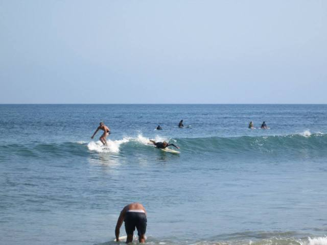 Surfers catching waves at Surfrider beach