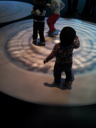 Not much to do for toddlers at the Museum of Science and Industry, but she found these water reflections entertaining